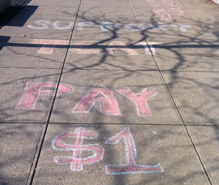 """""""$1"""" refers to the desired amount of subsidies protesting students want Cornell to pay TCAT per student ride."""